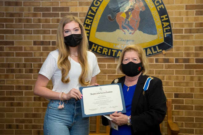 DAR representative Carolyn Rawlings, at right, presents Heritage Hall senior Lilly Roberson with theGood Citizens Program and Scholarship Contest award.