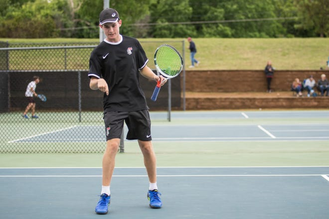 Crossings Christian's Daniel Haley celebrates by pointing to the ground during the 2019 boys tennis state tournament at OKC Tennis Center.