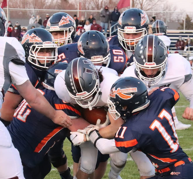 A host of Pontiac tacklers. led by Alex Trevino (11), Marcus Martinez and Dalton Tovrea (50) work to bring down a Tolono ballcarrier Friday at Williamson Field.
