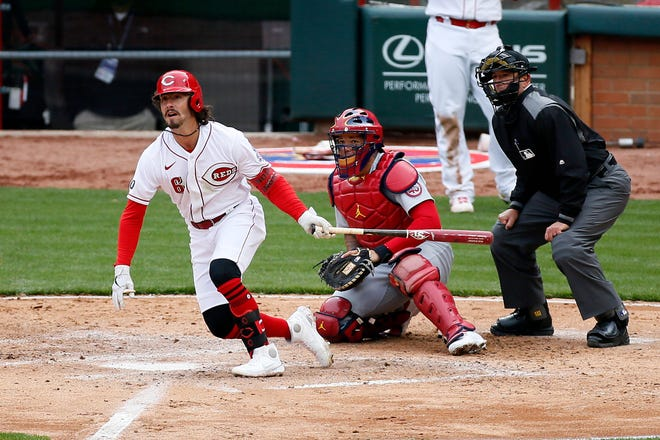Reds rookie second baseman Jonathan India hits a double - his first Major League hit - in the fourth inning of Thursday's season opener against the Cardinals in Cincinnati.