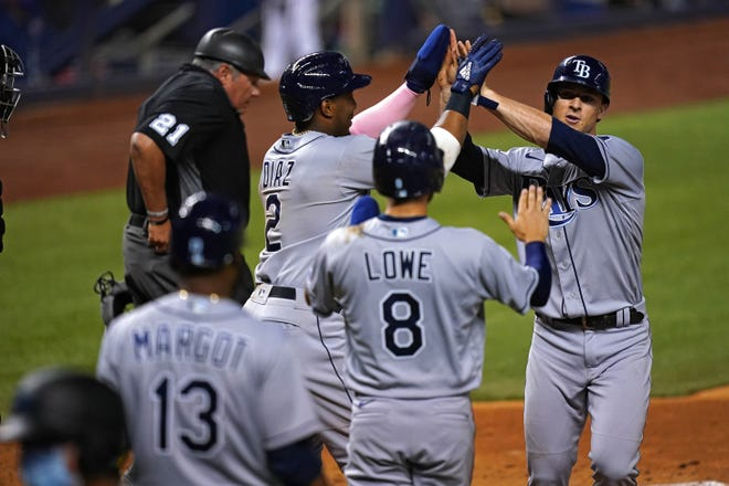 Rays third baseman Joey Wendle celebrates his three-run homer in the ninth inning against the Marlins on Friday night.