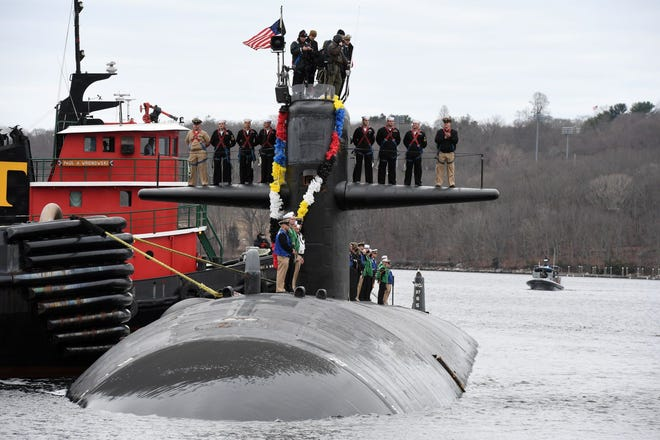 The Los Angeles-class submarine Providence arrives at Naval Submarine Base New London in Groton, Conn., on April 1 after its 16th and final deployment.