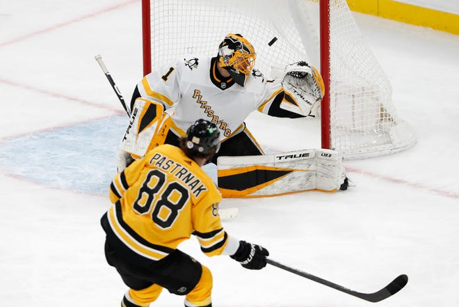 Boston Bruins' David Pastrnak scores on Pittsburgh Penguins goaltender Casey DeSmith during the third period of an NHL hockey game Saturday, April 3, 2021, in Boston. (AP Photo/Winslow Townson) ORG XMIT: BXG111