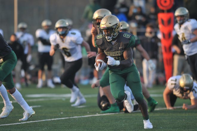 Hendricken's Isaiah Emmanuel, who ran for 142 yards on 13 carries, takes off for the left edge on his final carry of the game against North Kingstown on Saturday.
