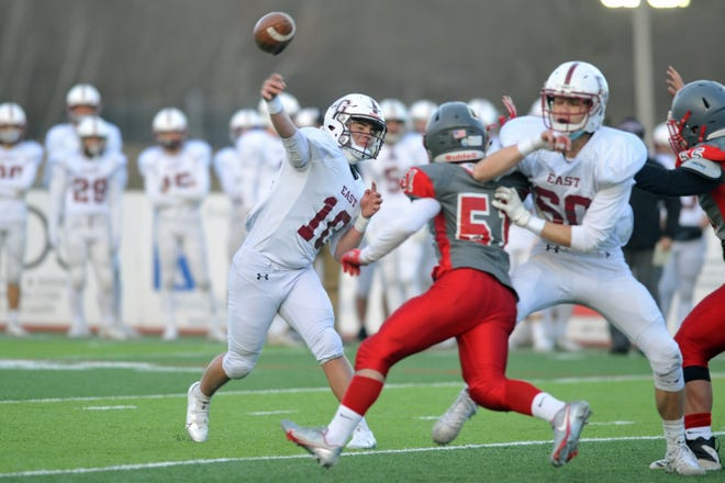East Greenwich's Parke Hardesky unleashes a perfect pass here in the first quarter to Jack McMullen that ended up as a 14-yard touchdown. Hardesky finished the game 11 of 15 passing for 169 yards and four TDs, his second straight game with 4 touchdown passes.
