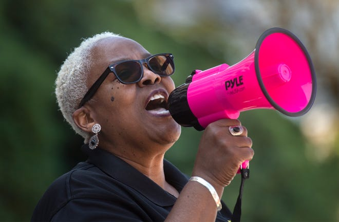 The Rev. Trena Turner, executive director of Faith In The Valley, uses a megaphone to lead a group of protesters in a chant in front of Stockton City Hall in April over the police beating of then-17-year-old Devin Carter on Dec. 30.