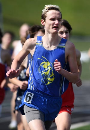 East Canton's Gabe Shilling competes in the 1,600-meter run at the Fairless Track and Field Invitational.