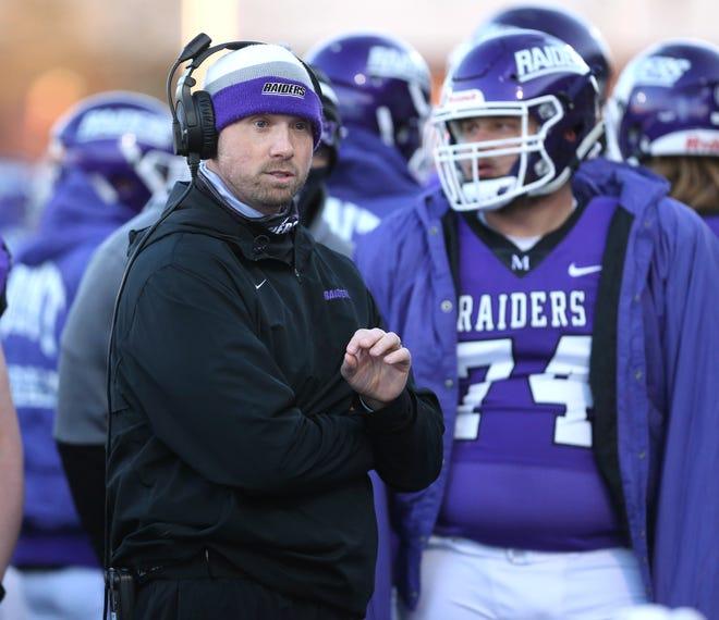 Geoff Dartt, Mount Union head football coach, leads his team during the Purple Raiders' game against Marietta in April.