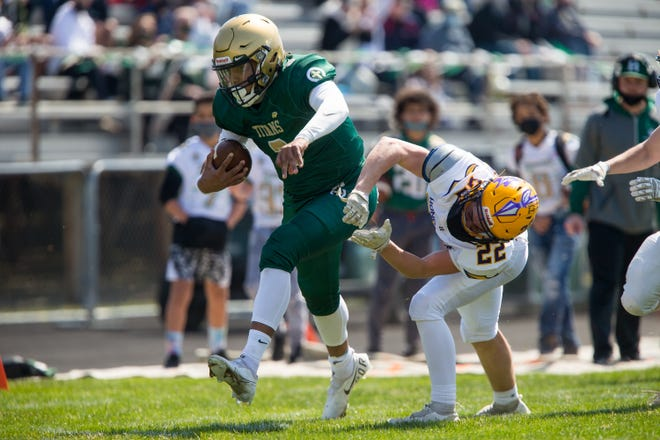 Boylan's Benny Jass beats a tackle attempt from Hononegah's Karsten Nordlie in the first quarter of their NIC-10 game at Boylan Catholic High School on Saturday, April 3, 2021, in Rockford.