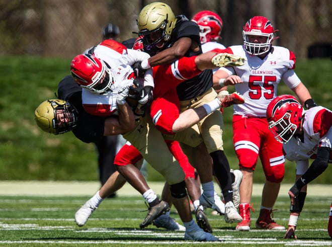 Sacred Heart-Griffin's Reese Edwards (13) throws Glenwood's Austin Bush (9) to the turf forcing a fumble that was recovered by the Cyclones in the first half at Ken Leonard Field in Springfield on Saturday. [Justin L. Fowler/The State Journal-Register]