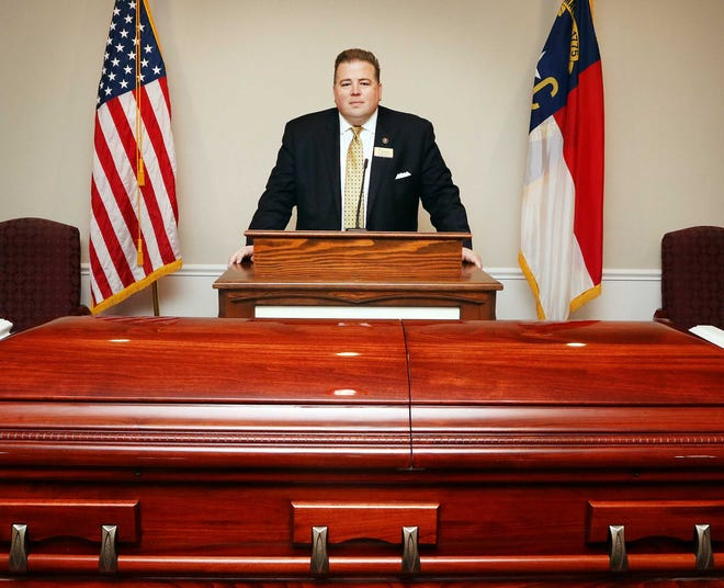 """Rex Allen Bennett is managing director at Cotten Funeral Home in New Bern, NC. Bennett, who also serves as a pastor, said he became interested in funeral homework while still in high school and considers the job to be a part of his """"spiritual calling."""" [Gray Whitley / Sun Journal Staff]"""