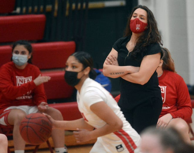 NFA girls basketball coach Courtney Gomez watches her team play against Waterford during the ECC South final at Alumni Gymnasium in Norwich.