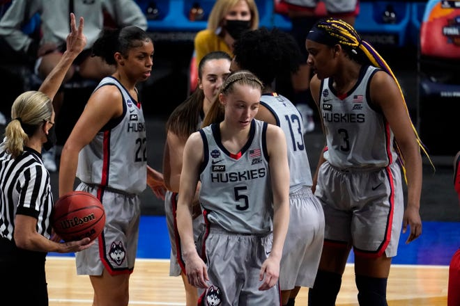 Connecticut guard Paige Bueckers (5) reacts after getting fouled during the second half of a women's Final Four NCAA college basketball tournament semifinal game against Arizona Friday, April 2, 2021, at the Alamodome in San Antonio.