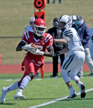 St. John's Keith Sarkodieh, shown here earlier in the season against St. John's Prep, hauled in a 37-yard scoring pass from Jacques Durocher during the third quarter of the Pioneers' 17-6 win Saturday at BC High.