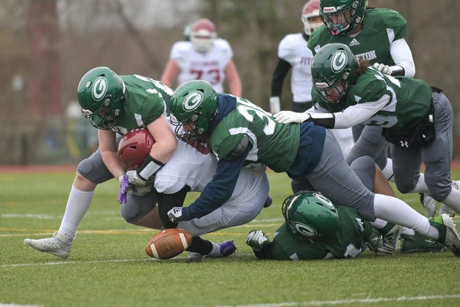 Grafton's Douglas Landry forces a fumble in the second half.