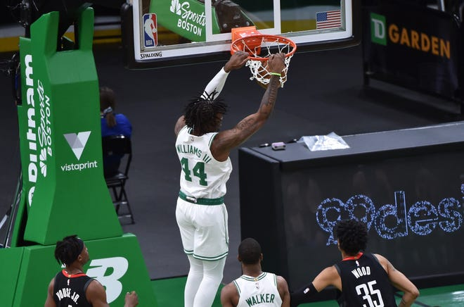 Celtics center Robert Williams dunks the ball during the first half against Houston Rockets Friday night at TD Garden.