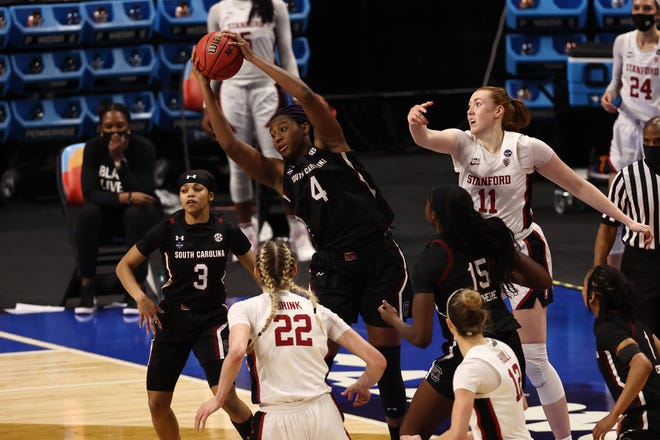 South Carolina forward Aliyah Boston (4) reaches for the ball in front of Stanford forward Ashten Prechtel (11) during the second half in a national semifinal in San Antonio.