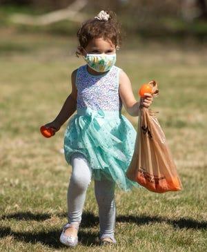 Alyssia Araujo, 3, participates in the Easter egg hunt.