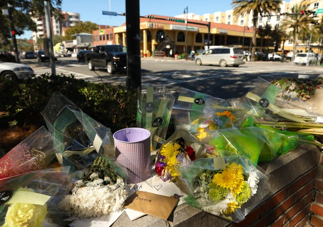 A memorial is set up for Sophia Lambert, who died in a recent car crash, at the corner of West University Ave. and 17th Street in Gainesville on Jan. 29. The City of Gainesville, the Gainesville Police Department, UF and the UF Police Department are starting an operation, which will last about 30 days to start off, that involves law enforcement using aggressive tactics to catch motorists that are not yielding right of way to pedestrians. The operation is in response to the recent deaths of two University of Florida students in crashes on University Avenue near campus. [Brad McClenny/The Gainesville Sun]