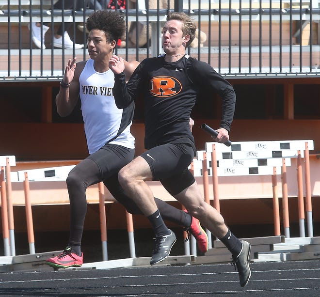 A race to the finish of the 4X100 between River View and Ridaewood at the J. D. Milbum Relays at Newcomerstown Saturday.