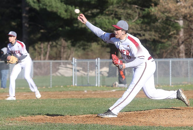Dover starting pitcher Brennan McCune throws a pitch in the game Friday with Massillon.