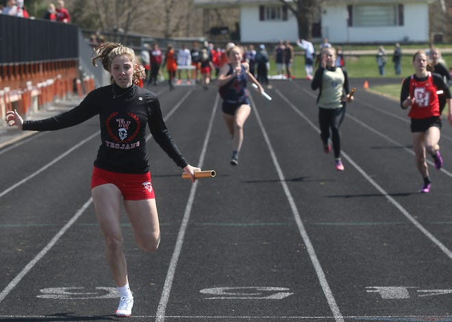 The finish of the 4X100 relay at the J. D. Milbum Relays at Newcomerstown Saturday.