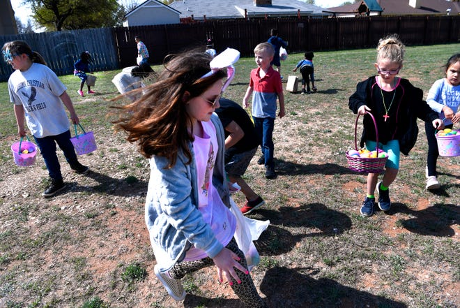 Swayze Harris, 10 and wearing bunny ears, jumps in to snatch an egg from the ground during an egg hunt at the new Antilley Road location of First Christian Church (Disciples of Christ) on Saturday. The church will have its first Easter Sunday service this weekend.
