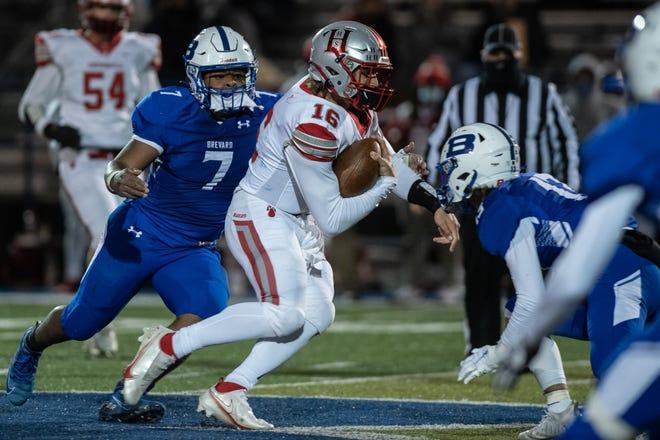 Hendersonville quarterback Gavin Gosnell scrambles for a big gain during Friday's win at Brevard. [MAYA CARTER/ ASHEVILLE CITIZEN-TIMES]