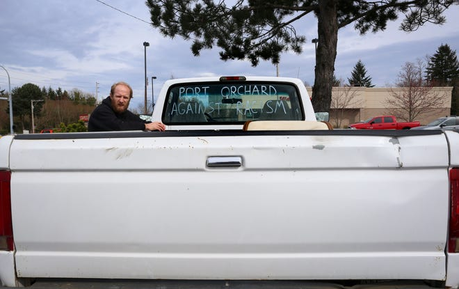 Matt Edlin was disheartened by anti-Asian racism happening within Port Orchard and the United States, so he decided to gather friends to write messages in defiance of racism on their cars.