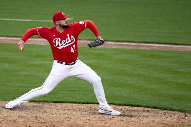 Cincinnati Reds starting pitcher Sal Romano (47) throws a pitch in the ninth inning of the MLB baseball game between Cincinnati Reds and St. Louis Cardinals at Great American Ball Park in Cincinnati on Saturday, April 3, 2021.