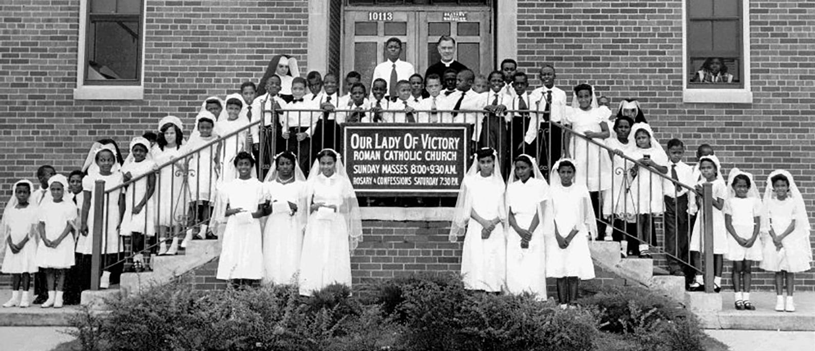 Here is a vintage photo of Our Lady of Victory Catholic School students, dressed to make their First Communion. The school was established in the 1940s near 8 Mile and Wyoming in Detroit to teach Black students who lived in Detroit and Royal Oak Township, across 8 Mile from the parish and school.