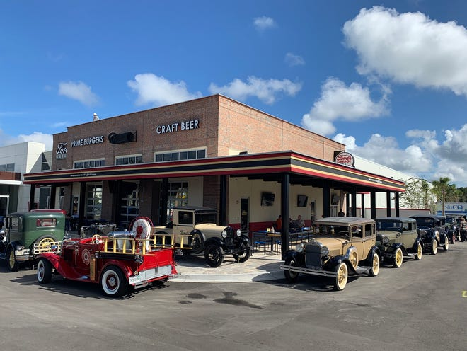 This Ford's Garage restaurant is the first to open at a Ford dealership in America, in St. Augustine, Florida on Sept. 24, 2020. It has exceeded sales expectations with 6,000 diners a week.