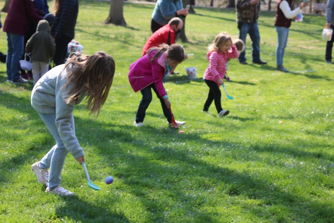 Area children of all ages participate in the traditional egg roll race at Spiegel Grove in Fremont on Saturday.