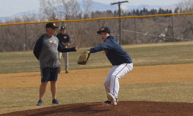Great Falls Chargers A right hander Nick Kidd, under the watchful eye of Charger AA coach Ed McNamee, throws during a scrimmage between the A and AA teams Friday at Don Olson Field.