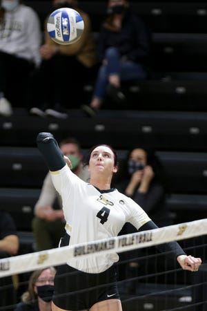 Purdue outside hitter Caitlyn Newton (4) spikes the ball during the second set of an NCAA women's volleyball game, Friday, April 2, 2021 at Holloway Gymnasium in West Lafayette.