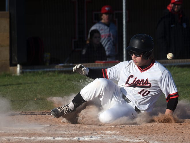 Brody Poston slides into home ahead of the throw during Liberty Union's 10-0 win against Williamsport Westfalll on April 2 in Baltimore.