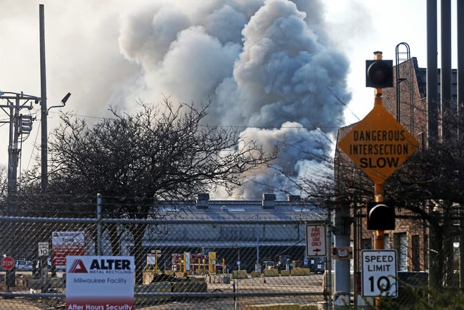A scrap yard fire at Alter Metal Recycling, 1640 W. Bruce St., sends smoke billowing over the Menomonee Valley on Saturday afternoon.