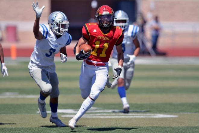 Centennial's Isaac Gutierrez breaks away for a touchdown on Saturday afternoon against the Carlsbad Cavemen.  Photo taken 4/3/21.