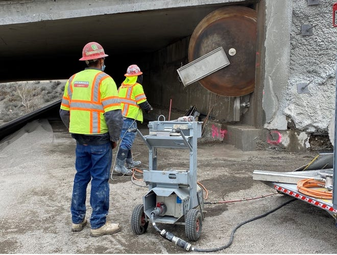 Workers operate saw cutting on the eastbound I-80 to northbound US 395 at Spaghetti Bowl Xpress.