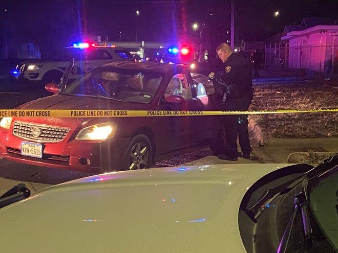 Wichita Falls Police work the scene of a reported shooting on Burnett Street Friday night.