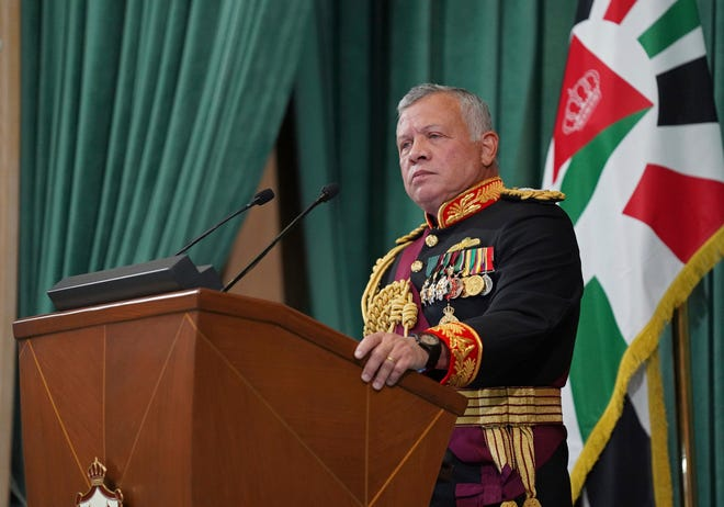 FILE - In this Dec. 10, 2020  photo released by the Royal Hashemite Court, Jordan's King Abdullah II gives a speech during the inauguration of the 19th Parliament's non-ordinary session, in Amman Jordan.