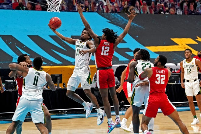 Baylor guard Adam Flagler (10) shoots the ball against Houston Cougars guard Tramon Mark (12) during their Final Four game.