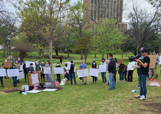Michael Wei addresses the crowd at a rally at the Texas Capitol on Saturday protesting violence and hate against people who are of Asian descent.