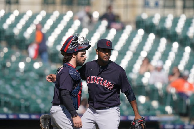 Cleveland relief pitcher Emmanuel Clase, right, hugs catcher Austin Hedges after the ninth inning of a baseball game against the Detroit Tigers, Sunday, April 4, 2021, in Detroit. Cleveland won 9-3. [Carlos Osorio/Associated Press]