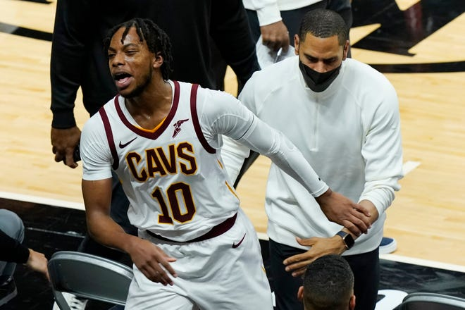 Cavaliers guard Darius Garland (10) is leaves the court after being ejected from a 115-101 loss to the Miami Heat on Saturday night. [Marta Lavandier/Associated Press]