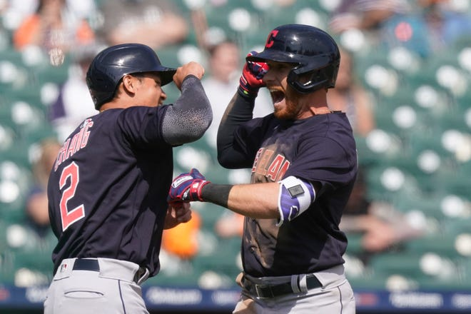 Cleveland's Jordan Luplow, right, is greeted by Yu Chang after they both scored on Luplow's two-run home run during the seventh inning of a baseball game against the Detroit Tigers, Sunday, April 4, 2021, in Detroit. [Carlos Osorio/Associated Press]