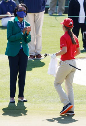 Condoleezza Rice greets Elyse Meerdink after she finished putting during the Drive, Chip and Putt National Finals at Augusta National Golf Club, Sunday, April 4, 2021, in Augusta, Georgia. Andrew Davis Tucker/The Augusta Chronicle.
