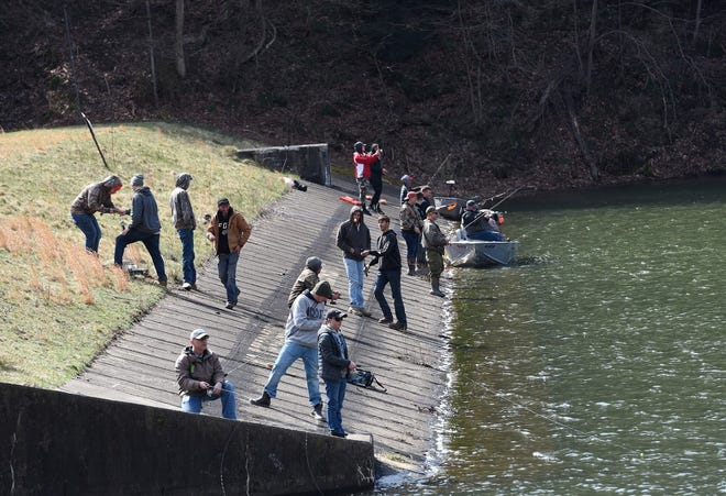 People gathered at Bradys Run Lake on Saturday morning for the first day of spring trout fishing.