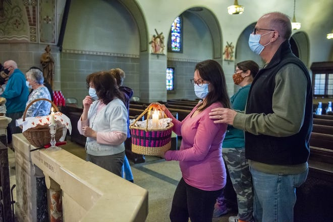 Marta and Terry Sasala of Center Township wait to have their Easter basket blessed during a short service Saturday at St. John the Baptist Church in Monaca.