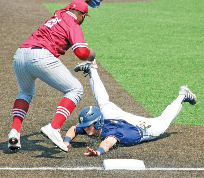 An Oklahoma Wesleyan University baserunner, right, scrambles safe into third base during Saturday's battle against Sterling (Kan.), at Bill Doenges Memorial Stadium.